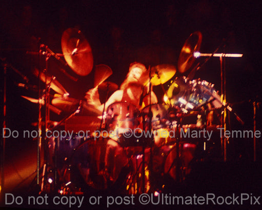 Photo of Barriemore Barlow of Jethro Tull in concert in 1976 by Marty Temme