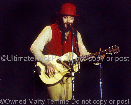 Photo of Ian Anderson of Jethro Tull playing guitar in 1976 by Marty Temme