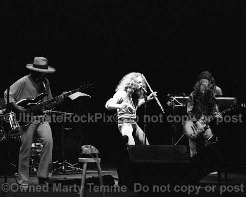 Photo of Ian Anderson and Jethro Tull in concert in 1973 by Marty Temme