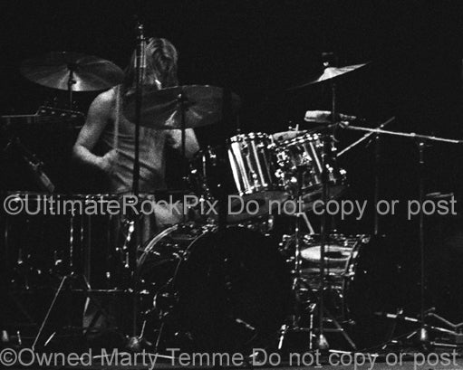 Photo of Barriemore Barlow of Jethro Tull in concert in 1973 by Marty Temme