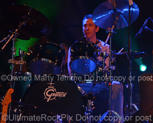 Photo of drummer Kofi Baker in concert in 2013 by Marty Temme