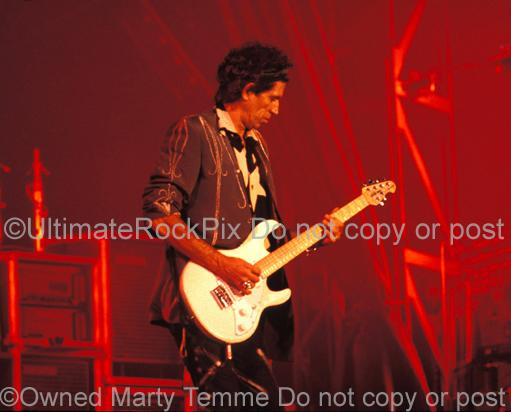 Photos of Guitarist Keith Richards of The Rolling Stones Playing a Music Man guitar in Concert in 1989 by Marty Temme