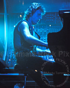 Photo of Keith Emerson of Emerson, Lake & Palmer performing in concert in 1992 by Marty Temme