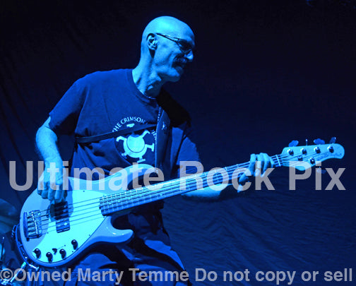 Photo of bass player Tony Levin of King Crimson in concert in 2012 by Marty Temme