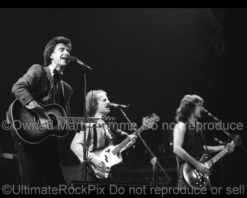Photo of Ray Davies, Dave Davies and Jim Rodford of The Kinks in 1979 by Marty Temme
