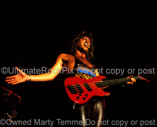 Photo of Kip Winger performing onstage in 1989 by Marty Temme