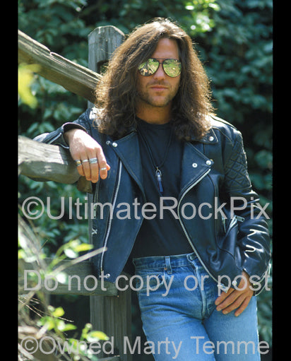 Photo of Kip Winger wearing sunglasses during a photo shoot in 1993 by Marty Temme