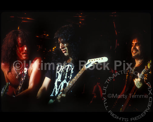 Photo of Paul Stanley, Bruce Kulick and Gene Simmons of Kiss in concert by Marty Temme