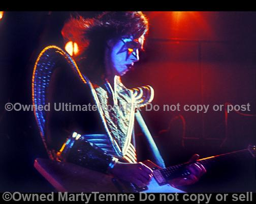 Photos of Ace Frehley of Kiss playing a Gibson Explorer in concert in the 1970's by Marty Temme