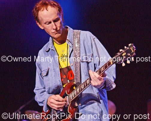 Photos of Guitar Player Robby Krieger Playing a Gibson SG in Concert in 2008 by Marty Temme