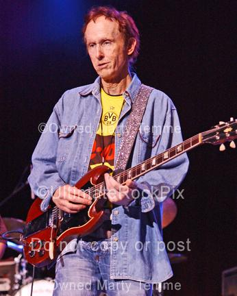 Photo of guitar player Robby Krieger of The Doors playing his Gibson SG onstage by Marty Temme
