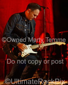 Photos of Guitar Player Keith Scott of Bryan Adamsin Concert by Marty Temme