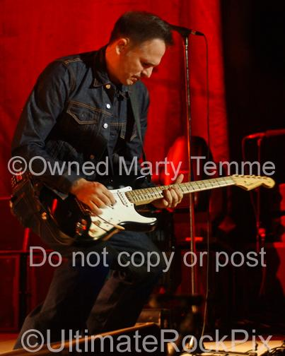 Photo of guitar player Keith Scott of Bryan Adams playing a Fender Stratocaster in concert by Marty Temme