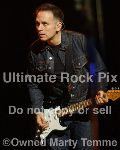 Photo of guitar player Keith Scott of Bryan Adams in concert by Marty Temme