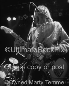 Black and white photo of Kurt Cobain of Nirvana performing in concert in 1991