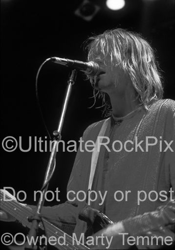 Black and white photo of Kurt Cobain of Nirvana in concert in 1991 by Marty Temme