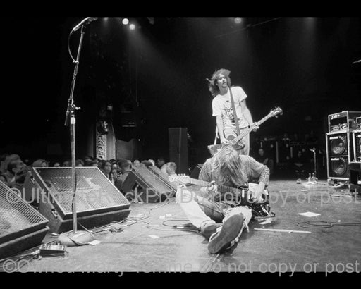 Black and white photo of Kurt Cobain of Nirvana sitting on the stage in 1991 by Marty Temme