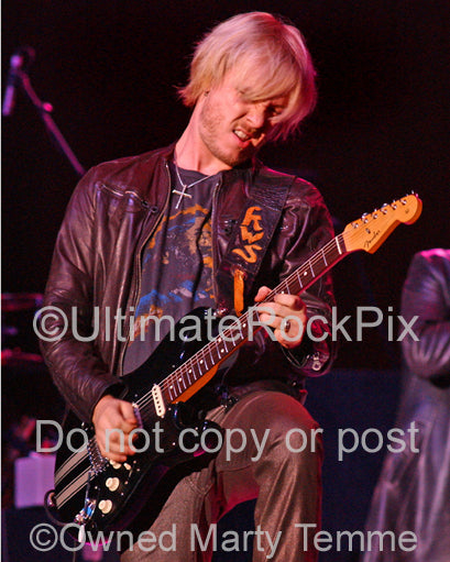 Photo of Kenny Wayne Shepherd playing a black Stratocaster in concert by Marty Temme