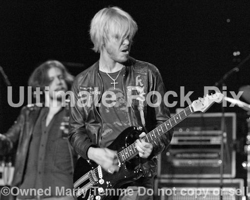 Black and white photo of Kenny Wayne Shepherd playing a Stratocaster onstage by Marty Temme