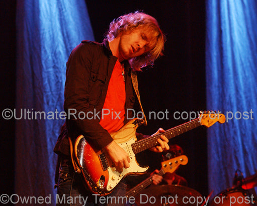 Photo of Kenny Wayne Shepherd playing a sunburst Stratocaster in concert in 2010 by Marty Temme
