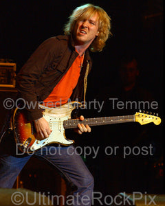 Photo of Kenny Wayne Shepherd playing a sunburst Stratocaster in concert by Marty Temme