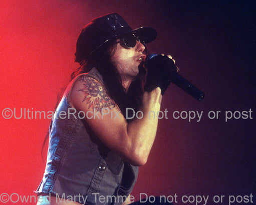 Photo of Phil Lewis of L.A. Guns in concert in 1991 by Marty Temme