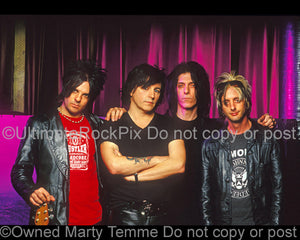 Photo of Stacey Blades, Phil Lewis, Steve Riley and Adam Hamilton of L.A. Guns during a photo shoot in 2005 by Marty Temme