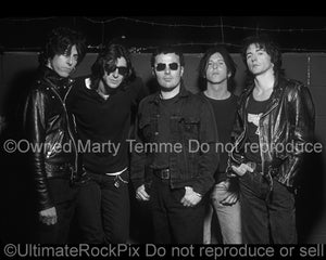 Black and white photo of Phil Lewis, Tracii Guns, Steve Riley, Kelly Nickels and Mick Cripps of L.A. Guns during a photo shoot in 1995 by Marty Temme