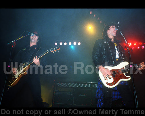 Photo of Mick Cripps and Kelly Nickels of L.A. Guns in concert in 1991 by Marty Temme