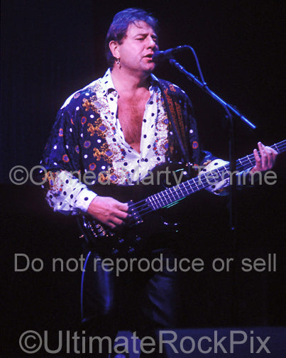 Photo of Greg Lake of Emerson, Lake & Palmer in concert in 1992 by Marty Temme