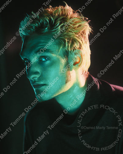 Photo of Layne Staley looking into the camera during a photo shoot by Marty Temme