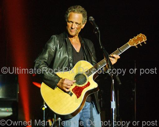 Photos of Guitarist Lindsey Buckingham of Fleetwood Mac Playing a Taylor Acoustic Guitar in Concert