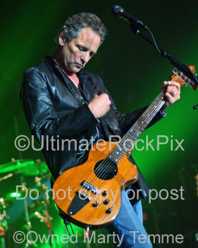 Photo of Lindsey Buckingham of Fleetwood Mac playing a Rick Turner guitar in concert in by Marty Temme