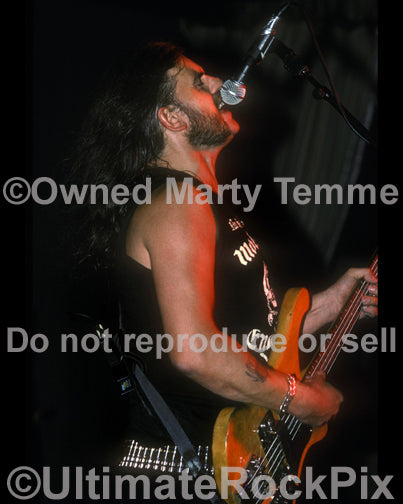 Photo of Lemmy Kilmister of Motorhead in concert in 1990 by Marty Temme