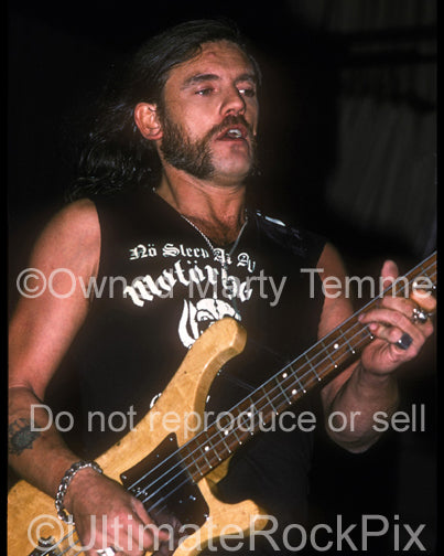 Photo of Lemmy Kilmister of Motorhead performing in concert in 1990 by Marty Temme