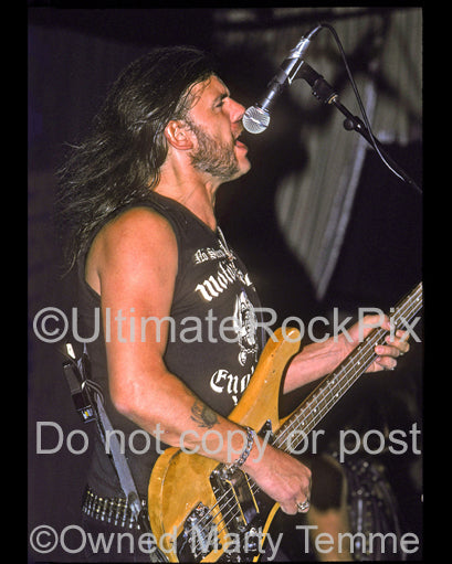 Photo of Lemmy Kilmister of Motorhead performing onstage in 1990 by Marty Temme