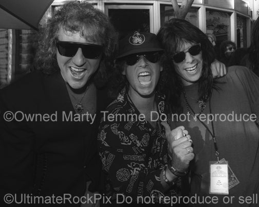 Photo of Joe Leste of Bang Tango and Herman Rarebell and Klaus Meine of Scorpions in 1991 by Marty Temme