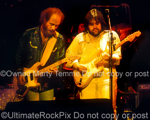 Photo of Lowell George and Paul Barrere of Little Feat onstage in 1978 by Marty Temme