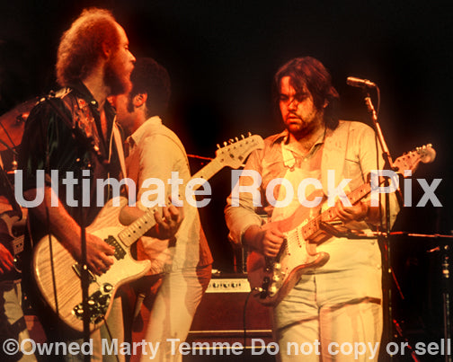 Photo of Lowell George and Paul Barrere of Little Feat in concert in 1978 by Marty Temme