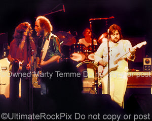 Photo of Lowell George, Bonnie Raitt and Paul Barrere of Little Feat in 1978 by Marty Temme
