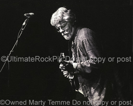 Photo of musician Fred Tackett of Little Feat in concert in 2002 by Marty Temme