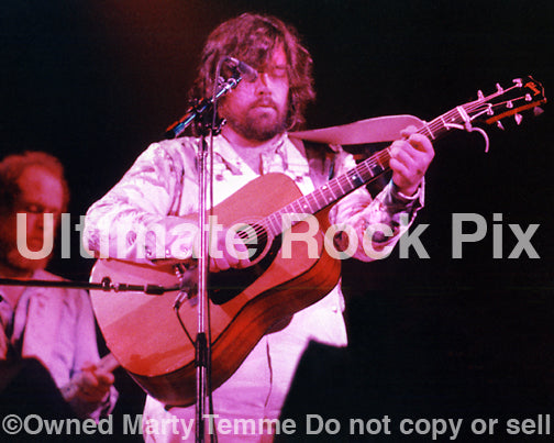Photo of Lowell George of Little Feat playing a Gibson acoustic in concert in 1977 by Marty Temme