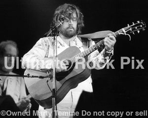 Black and white photo of Lowell George of Little Feat playing a Gibson acoustic in 1977 by Marty Temme