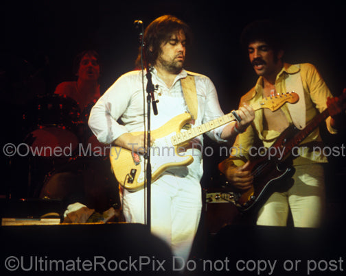 Photo of Lowell George and Kenny Gradney of Little Feat in 1978 by Marty Temme