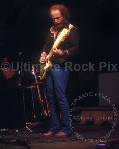 Photo of Paul Barrere of Little Feat playing a Music Man StingRay guitar in 1977 by Marty Temme