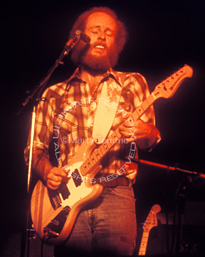 Photo of guitarist Paul Barrere of Little Feat in concert in 1978 by Marty Temme