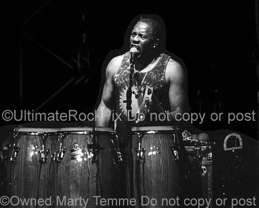 Black and white photo of percussionist Sam Clayton of Little Feat in concert in 2002 by Marty Temme