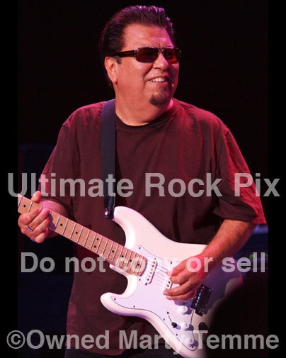 Photo of guitarist Cesar Rojas of Los Lobos in concert