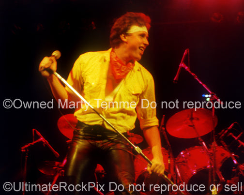 Photo of singer Mike Reno of Loverboy in concert in 1981 by Marty Temme
