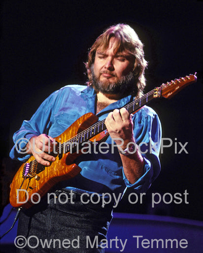 Photo of Ed King of Lynyrd Skynyrd in concert in 1991 by Marty Temme